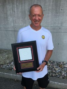 Philpott Supervisor Alan Brown Receives a Distinguished Service Award from Tennis Canada